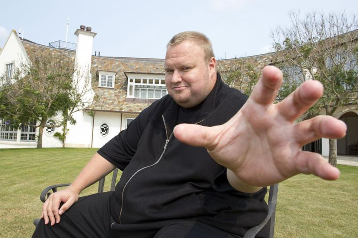 "Kim Dotcom gestures towards a camera after an interview with Reuters in Auckland January 19, 2013. Dotcom is launching his new cloud storage service ""Mega"" at his Dotcom Mansion in Coatsville, Auckland on Sunday.  REUTERS/Nigel Marple (NEW ZEALAND - Tags: SCIENCE TECHNOLOGY BUSINESS) - RTR3CMN9"